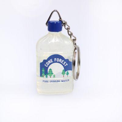 Брелок из ПВХ в виде бутылки воды прозрачного цвета